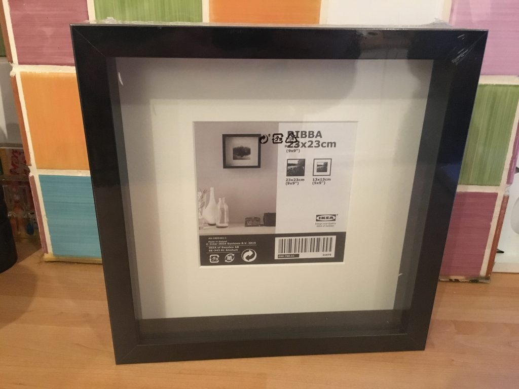 Get yourself an Ikea 23cm by 23cm square frame